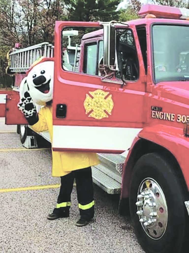 Adams County Fire District newest member, Sparky, (costume donated by Stevens Point Fire Dept) spent time with students at Adams-Friendship...