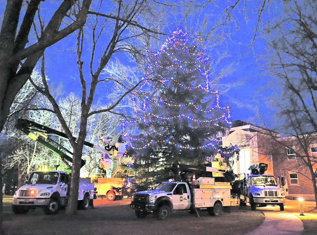 ACEC employees volunteered thier time to bring Chistmas to the Adams County Courthouse. Bucket trucks were used to string lights on the...